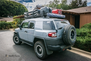 Our FJ with the awning, water tank and jerry cans mounted on the