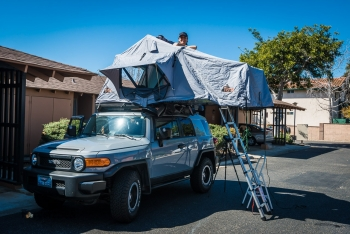 CrtrGrl testing out the roof top tent